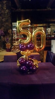 Fabulous Fifty Centerpiece #fabulousfifty #50TH ##centerpieces #balloonnumbers #celebrations #party #birthday #goldballoons #balloonarrangements #balloonartist #certifiedballoonartist #cba #foilballoons #foilart #foilballoonnumbers #purpleballoons  #goldballoons