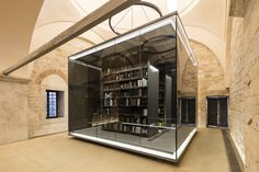 Rare books in a controlled environment cabin at the oldest library in Istanbul - Beyazit Public Library. photo by Emre Dörter [1500x1000]