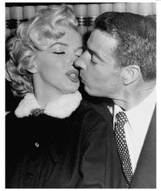 Marilyn Monroe and Joe DiMaggio share a kiss March 14, 1954, in San Francisco. There are many slang words for kissing: smooching, pecking, snogging, giving some sugar, tongue wrestling and tonsil hockey.