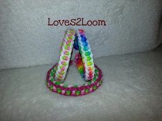 Rainbow Loom DAINTY TWIST Bracelet (reversible). Designed and loomed by Loves2Loom. Click photo for YouTube tutorial. 06/09/14.