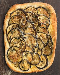 Start with store-bought pizza dough and finish with a quick, crowd-pleasing vegetarian snack. Transform it into a main course with the addition of a green salad. #EggplantPizzaRecipe