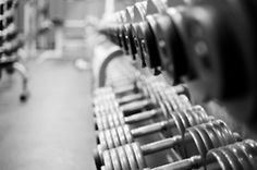 For guys, working out isn't cardio classes or a pristine yoga studio, it's a dark dingy gym with heavy weights.