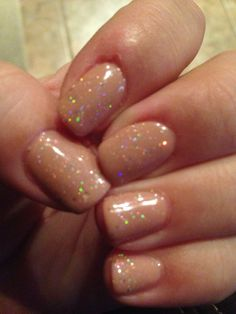 Nude gel nails with iridescent sparkle