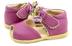 Merry Bell Violet Toddler  Merry Bell evokes the feeling of frolic and fancy in childhood summers - think a secret garden with delicate vines and falling blossoms. With its dangling tassels and scalloped edging in contrasting color, this open-toe sandal is feminine and sweet. In violet leather with a chartreuse and violet flower and chartreuse scalloping.