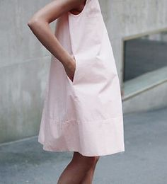 Cute pink tent dress. Throw a mini cross-body camel purse and you're good to go.