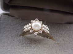 Vintage Pearl and Diamond ring .90 Ctw by estatejewelryshop, $575.00