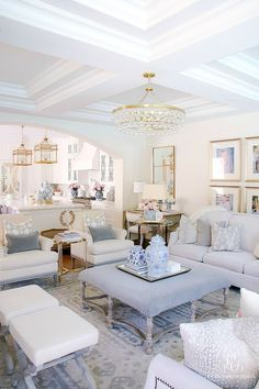 Soft blues team up alongside white and gold to create an inviting, breathtaking living room color scheme. With pops of vintage china, this entertaining space is totally inspiration worthy.