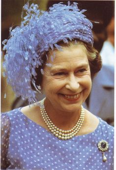 Queen Elizabeth wearing the Empress Marie brooch that she inherited upon her coronation.