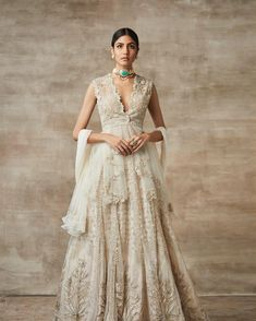 Check out our Ivory Hand Embellished Lehenga Set by RIDHI MEHRA available at Ogaan Online store at special price. Ivory hand embellished lehenga set Comes along top with frill at bottom Hand and machine embellished Fabric- Net, Raw silk and Organza Indian Wedding Lehenga, Bridal Lehenga, Indian Dresses, Indian Outfits, Raw Silk Lehenga, Indian Couture, Indian Designer Wear, Indian Fashion, Style Fashion