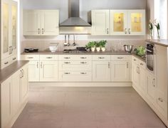 Cream Kitchen Ideas Uk light cream kitchen simple cream units teamed with white floor and