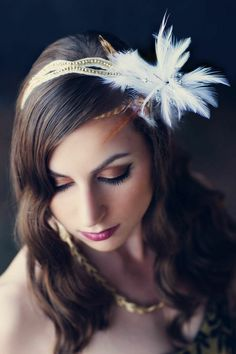 Make your own show stopping hair piece with faux flowers and feathers from Afloral.com