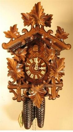 Cuckoo Clock, Black Forest, Hand Carved Grape Leaves, Model #8250.