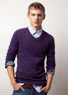 V neck purple sweater, grey shirt and black pants. No tie ...