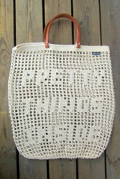 Versatile, amazing and stylish CROCHET TOTE BAG. The bag looks delicate but at the same time it is sturdy. The design allows it to stretch to accommodate bulky or awkward shapes . The handles are made of leather. MEASUREMENTS: Width: 12inch / 30cm Height: 16inch / 40cm LEATHER HANDLES LENGTH 14inch / 36cm MATERIALS: 100% COTTON with genuine LEATHER HANDLES COLOR: Color may vary based upon your screen resolution and other computer settings outside of our control. CUSTOM ORDE...
