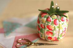 Pincushion made using a Martha Stewart tomato pincushion pattern.