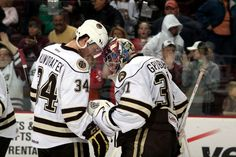 1.12.13 - Bears vs. Whale.  Post game victory moment with Kundratek and Grubauer.  Photo courtesy of JustSports Photography