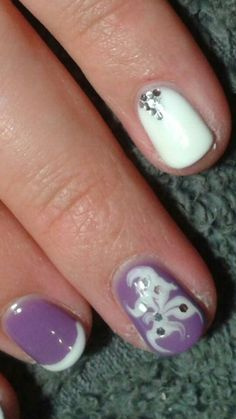 Purple and white gel nail design