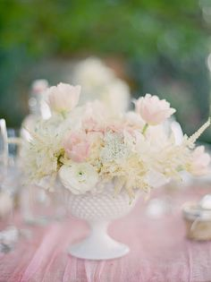 Different flowers with cotton as low centerpieces.