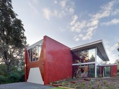 """Something different by Wowowa Architecture! Nestled in amongst the banksia trees and coastal scrub on the Silverleaves foreshore is a pair of glistening red fins – a bold response to the client's brief for """"a grand gesture on limited means"""". The client repeatedly mentioned she was going to plant loads of the local ruby-red bottlebrushes when the house was finished and wanted the home to fit in with the landscape. Via: www.wowowa.com.au/portfolio/finn-house"""