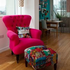 Bamboo flooring, pink armchair, patterned footstool, in open-plan space there is table and chairs. Bedroom Chairs Uk, Small Chair For Bedroom, Bedroom Red, Colourful Living Room, Small Living Rooms, Living Room Decor, Living Area, Red Accent Chair, Accent Chairs
