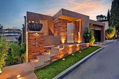 Fachada de casa de piedra de un piso