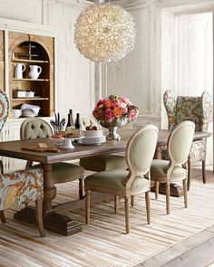 High-Ceilinged Dining Room with Fanciful Chairs