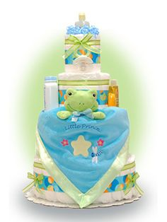 Our lil' prince frog security blanket finds a home on this 4 tier Blue Satin Frog Cake. The new baby will be able to carry around a security blanket that tells the world he is is a prince. Only $89.00