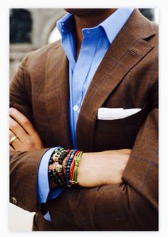 Brown and blue--no bracelets! Maybe a nice leather watch.