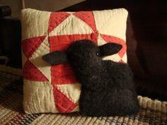 Antique quilt black sheep pillow
