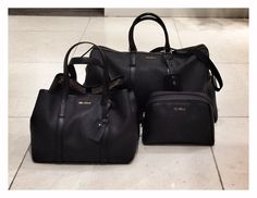 SS 2014 Collection: Black canvas and leather travel | every day and cosmetic bags.  Price on request.