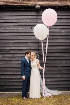 Pink and white wedding balloons |    Photography by http://www.fayecornhillphotography.co.uk/