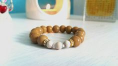 Made with genuine petrified wood and howlite gemstones. View our shop for more info Spiritual Prayers, Yoga Mala, Petrified Wood, Gemstone Bracelets, Stress Relief, Healing, Gemstones, Shop, Handmade