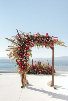 Isn't this floral wedding arbour incredible?! Filled with bougainvillea, pampas grass and roses, there's so much prettiness to love in this Bohemian Santorini wedding shoot. Check out the full photos and shoot on Wedding Vault. Photo by Kimon Kaketsis. #arbour #weddingarbour #floralarbour #ceremonyideas #pampasgrass #arbor Wedding Arches, Wedding Ceremony Backdrop, Wedding Shoot, Boho Wedding, Floral Wedding, Wedding Signage, Summer Wedding, Rustic Wedding, Outdoor Wedding Inspiration