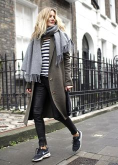 Show off your sophisticated side in an olive coat and black leather slim pants. Go for a pair of black and white trainers for a more relaxed aesthetic.   Shop this look on Lookastic: https://lookastic.com/women/looks/coat-crew-neck-sweater-skinny-pants/21283   — Grey Scarf  — White and Black Horizontal Striped Crew-neck Sweater  — Olive Coat  — Black Leather Clutch  — Black Leather Skinny Pants  — Black and White Athletic Shoes