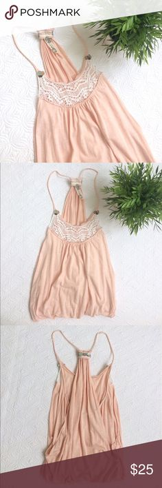 Pale peach Free People billowy top Super boho Free People top with billowy fabric that is pulled in at the waist. Excellent condition. No rips, tears, or stains. Free People Tops