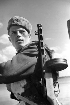 Portrait of a Soviet partisan during the Siege of Leningrad. Leningrad (St. Petersburg) region, Russia, Soviet Union. April 1943. Photograph by Mikhail Trakhman.