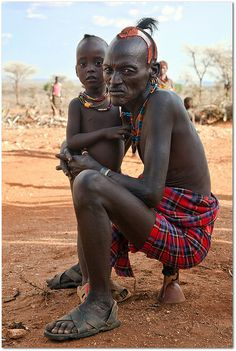 Hamer Grandpa, Ethiopia...  This man is sitting on a wooden pillow or headrest. These are common house hold items amongst Ethiopian various ...