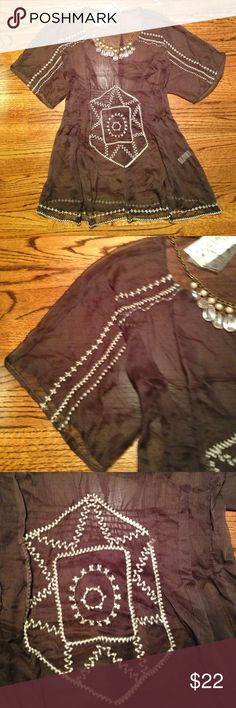 """NWT Shear Blouse Cute embroidered tunic-like top. Ties in back. Has elastic across the back at all he waist. 100% polyester. Size large. Super adorable for layering. Measures 31"""" from top of shoulder to bottom of hem. When lying flat, measures 17"""" across under armpits. Cecico Tops Tunics"""