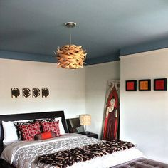 """A painted ceiling that """"bleeds"""" onto the walls helps to change the overall depth of this bedroom."""