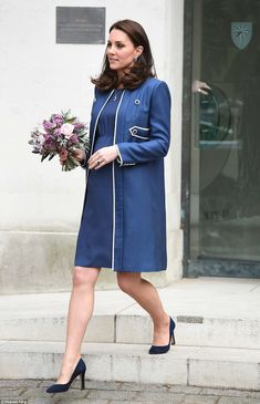 The Duchess could be seen clutching a colourful bouquet of flowers as she left the RCOG in...