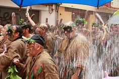 Corpus Christi parade in Valencia, #Spain. If you see buckets hanging above you. You WILL get absolutely drenched. An umbrella won't help.