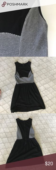Anthropologie Dress (Tart brand) Grey and black dress from Anthro. Large but fits like a medium. Cute with a long sleeved tee layered underneath or with a jacket over. Good used condition, some signs of wear. Anthropologie Dresses