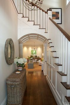 Love the juxtaposition of the curves and angles!  Love the skinny tall basket in the entry way