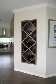 Wine rack built between wall studs. I don't drink enough wine for this, but love the way it looks.