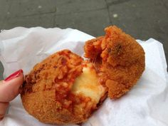 Suppli is regarded as one of Rome's best street foods. Learn why and get a recipe for these tasty Roman foods on the Eating Italy Travel Blog