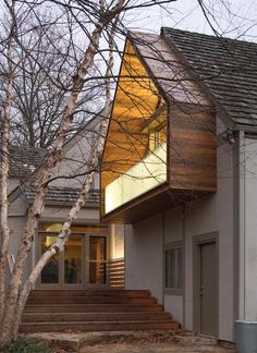 The cantilevered balcony offers a dry spot for the family dog on the steps.