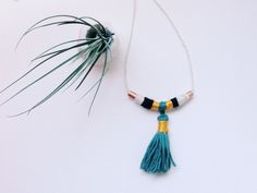 DIY copper tubing yarn wrapped tassel necklace, on the blog!