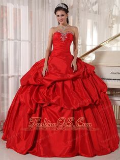 Vintage Red Quinceanera Dress Sweetheart Taffeta Beading Ball Gown http://www.fashionos.com Strapless dresses are one of the sexier styles on the market today. They show just enough skin to be classy without being too revealing. It features a pretty strapless bodice with a sweetheart neckline. The bodice is embellished with beading and rhinestones. The multi-tiered skirt features ruching for added detail, but still maintains its vintage A-line style. Such a girly, feminine dress for any…