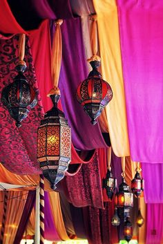 Moroccan tent decor. Colorful drapes and lovely Moroccan lanterns.