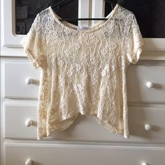 Butterfly back lace top This top is SO cute and flattering! Worn a couple of times but it's in perfect condition. Buttons down the back & butterfly winged bottom in the back. Gorgeous pattern Sans Souci Tops
